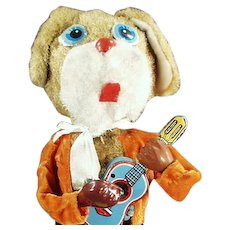 Vintage Wind-up Dog Playing a Musical Guitar - Tin & Plush Toy - Watch on Facebook
