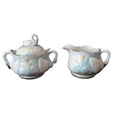 Vintage Porcelain Cream and Sugar Set with Delicate Swan Handles