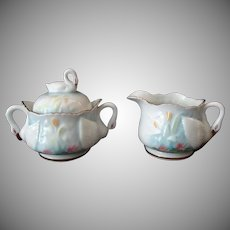 Vintage Porcelain Cream and Sugar Set with Delicate Swan Handles