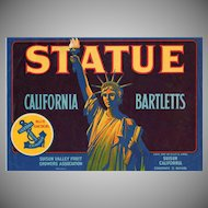 Vintage Fruit Crate Label with Colorful Statue of Liberty Graphics
