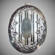 Shiny Vintage Silvertone Picture Locket - Oval Locket with Floral Design