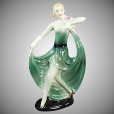 Vintage Deco Porcelain Figurine -Girl in a Flared Green Dress