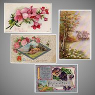 Four Vintage Postcards with Serene Views and Colorful Flowers