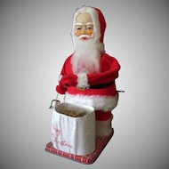 Vintage Wind-up Santa Claus Toy with Surprise Christmas Present – See on Facebook