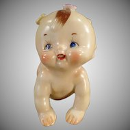 Vintage Ceramic Crawling Kewpie-Like Baby with Applied Flowers