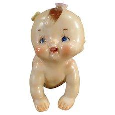 Vintage Ceramic Crawling Kewpie-Like Baby with Applied Flowers