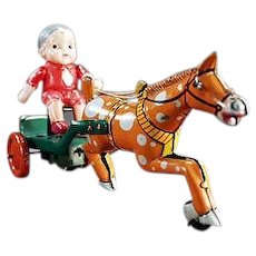 Vintage Celluloid and Tin Wind Up Toy - Boy on a Horse Cart