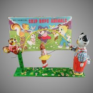 Vintage T.P.S. Wind-up Skip Rope Animals Tin Toy with Original Box