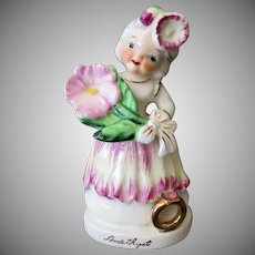 Vintage Porcelain Birthday Figure for February with Flower and Amethyst Birthstone