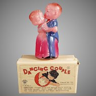 Vintage Celluloid Occupied Japan Wind Up Toy - O. J. Dancing Couple with Box