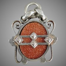 Vintage Goldstone Watch Fob or Pendant with Unusual Silver Colored Mount