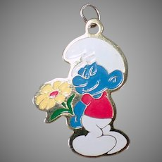 Vintage 1980 Peyo Smurf Charm or Pendant - Smiling Blue Smurf with Yellow Flower