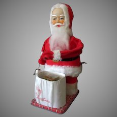 Vintage Santa Claus Wind-up Toy with Surprise Christmas Present – See on Facebook