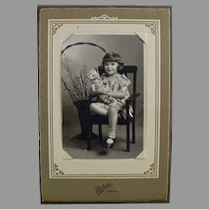 Vintage Photograph with a Little Girl and an Old Teddy Bear
