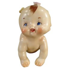 Vintage Ceramic Crawling Kewpie Baby with Applied Flowers - Made in Japan