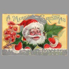 Colorful Vintage Christmas Postcard with Jolly Santa Claus and Christmas Holly