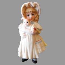 Vintage 1984 Jan Hagara Christmas Ornament – Victorian Girl with Bye-Lo Baby Doll