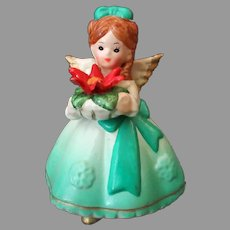 Vintage Ceramic Holiday Angel Dressed in Green with Christmas Poinsettia