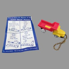 Vintage Puzzle Key Chain Toy - Colorful Dump Truck with Original Instructions