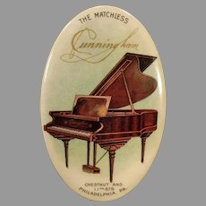Vintage Celluloid Advertising Mirror The Matchless Cunningham Piano Company with Grand Piano