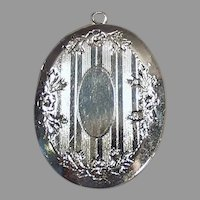Shiny Vintage Silvertone Picture Locket - Oval with Floral Design