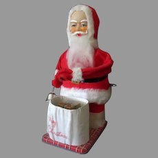 Vintage Wind-up Toy Santa Claus with Surprise Christmas Present – See on Facebook
