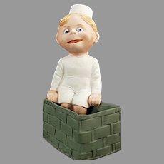 Vintage German Bisque Figurine Novelty - Googly-eyed Child Sitting on a Basket