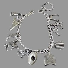 Vintage Charm Bracelet with ( 15) Fifteen Western Motif Charms and Sterling Chain