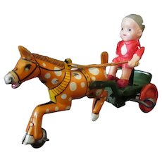 Vintage Celluloid and Tin Wind Up Toy, Made in Japan  - Boy on a Horse Cart