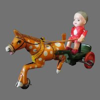 Vintage Japanese Tin Wind Up Toy with Celluloid Boy on a Horse Cart