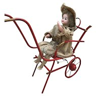 Antique French toy, bisque doll in carriage