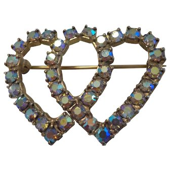 A Double Heart Pin set with Aurora Borealis colored Rhinestones