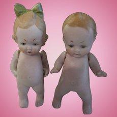 "German Bisque 3"" Boy and Girl Dolls"