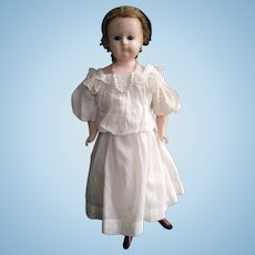 Wax over papier-mache doll (circa 1860)