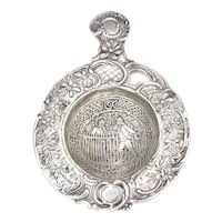Antique silver tea strainer decorated with Lady and Gentleman