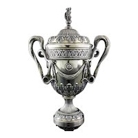 Antique sterling silver trophy cup with snake handles and decorative engravings