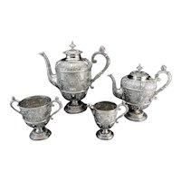 Antique Victorian sterling 925/1000 silver 'Cellini' pattern four-piece tea set.