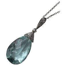 An Art Deco Aquamarine and Diamond Pendant
