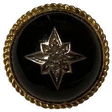 A Victorain Onyx and Diamond 15 Karat Gold Starburst Brooch
