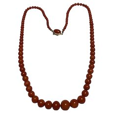 A Natural Coral Necklace With 18k Clasp