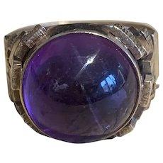 A Large Cabochon Amethyst Modern Ring