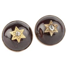 A Pair of Cabochon Garnet and Diamond Star Earrings