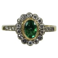 An Emerald and Diamond 18k Gold Ring