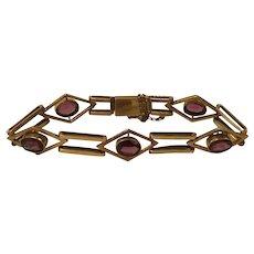 An Art Deco 9k Gold Rhodolite Garnet Bracelet