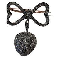 A Diamond Heart and Ribbon Brooch