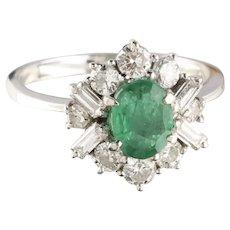 An Emerald and Diamond Set 18 Karat Gold Dress Ring