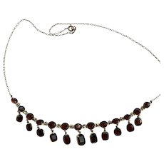 An Edwardian Almandine Garnet 9 Karat Gold Necklace