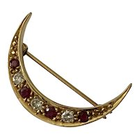 An 18 Karat Gold Diamond and Ruby Crescent Brooch