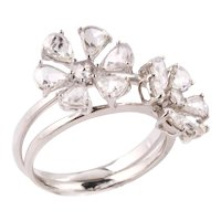 Flower shaped rings with rose-cut diamonds and white gold