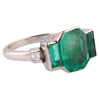 Emerald and diamonds platinum ring